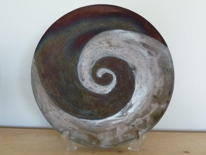 Raku, platter with light and dark spiral design
