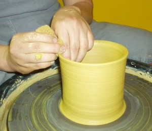 Eunsil Kim using the potters wheel